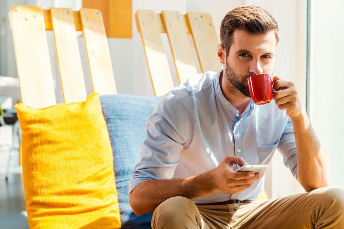 A man drinking coffee NAET Dubai