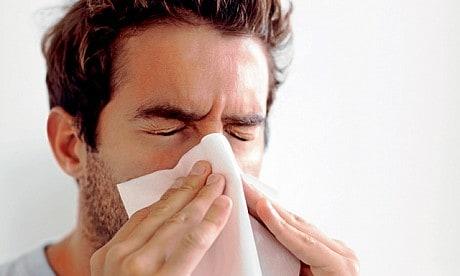 A man sneezing NAET Dubai