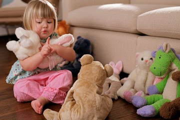 Child playing and talking with toys - NAET Dubai
