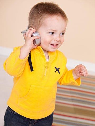 24 month baby listening to music - NAET Dubai
