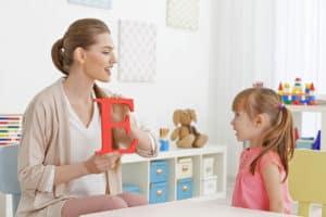 A child learning to speak - NAET Dubai