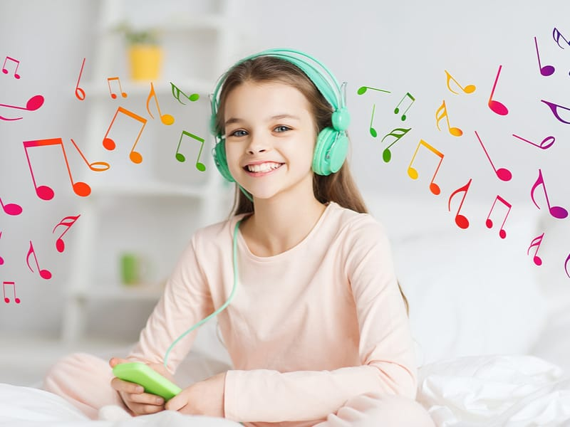 Child listening to music - NAET Dubai